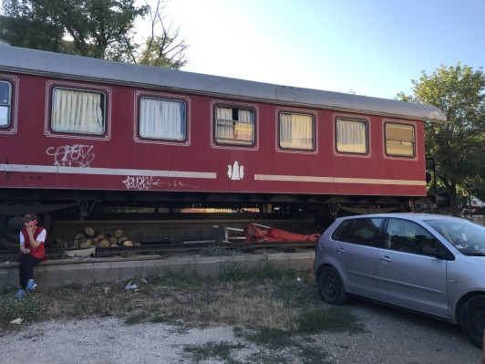 Train car restaurant in front of the massage place